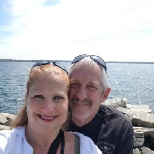 Image of Laure and bill by ocean